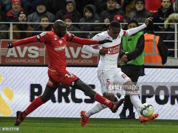 Toulouse's French defender Issa Diop vies with Dijon's Cap Verde forward Julio Tavares during the French L1 football match between Dijon and Toulouse...