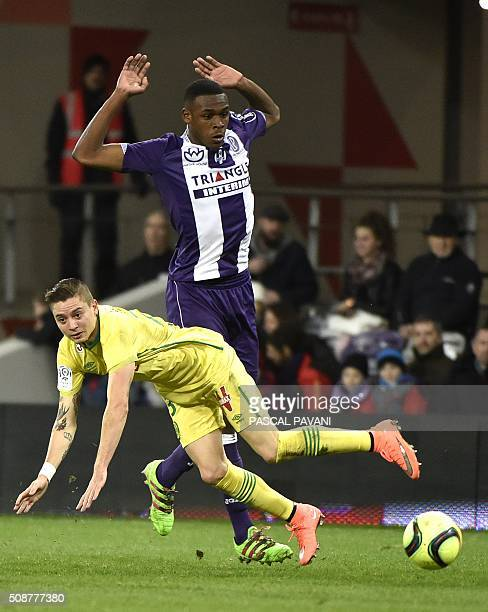 Toulouse's French defender Issa Diop vies with Nantes' Brazilian midfielder Adryan Oliveira Tavares during the French L1 football match Toulouse...