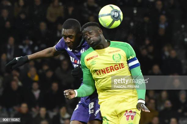 Toulouse's French defender Issa Diop vies with Nantes' French midfielder Abdoulaye Toure during the French L1 football match Toulouse against Nantes...