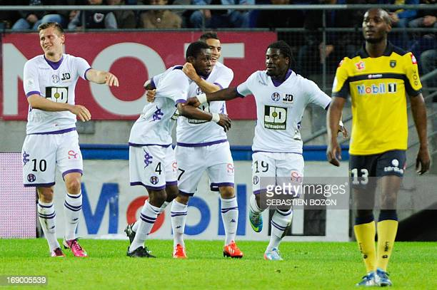 Toulouse's French defender Jean-Daniel Akpa Akpro is congratulated by teammates after scoring a goal during the French L1 football match Sochaux...