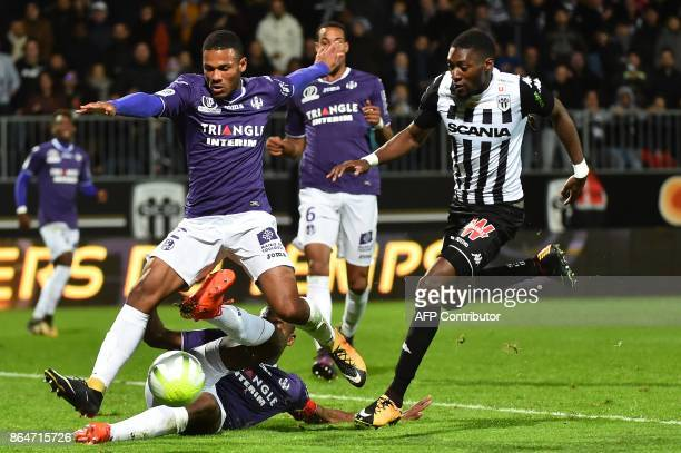 Toulouse's French defender Kelvin Amian and Toulouse's French defender Issa Diop vie with Angers' Cameroonian forward Karl Toko Ekambi during the...