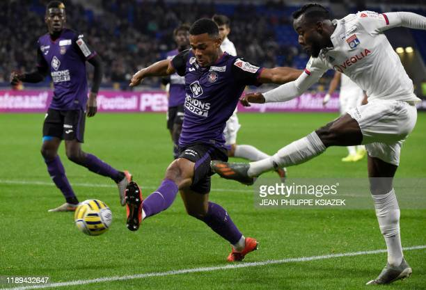 Toulouse's French defender Kelvin Amian fights for the ball with Lyon's Ivorian forward Maxwell Gnaly Cornet during the French League Cup football...