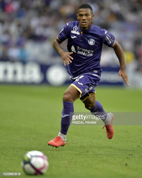 Toulouse's French defender Kelvin Amian runs with the ball during the French L1 football match between Toulouse and Nimes on August 25 2018 at the...