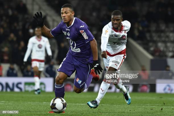 Toulouse's French defender Kelvin Amian vies for the ball with Bordeaux's Senegalese midfielder Younousse Sankhare during the French League Cup round...