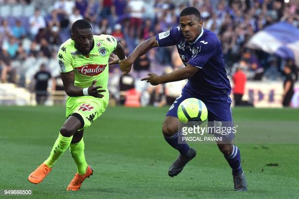 Toulouse's French defender Kelvin Amian vies with Angers' Cameroonian forward Karl Toko Ekambi during the French L1 football match Toulouse against...