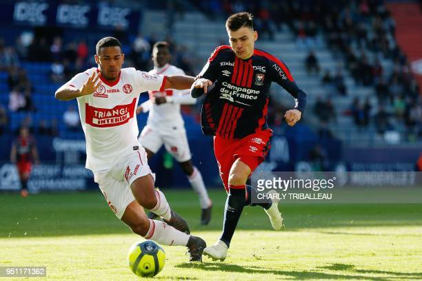 Toulouse's French defender Kelvin Amian vies with Caen's French defender Jessy Deminguet during the French L1 football match between Caen and...