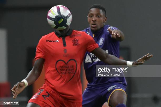Toulouse's French defender Steven Moreira vies with Nice's Senegalese defender Racine Coly during the French L1 football match between Toulouse and...