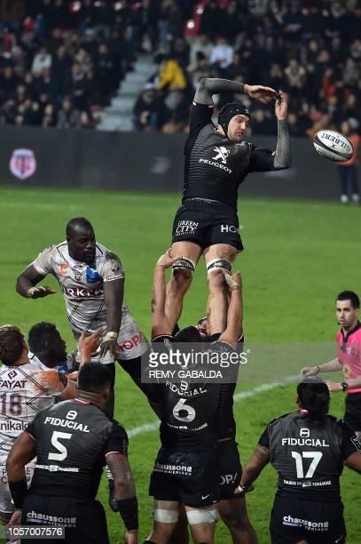 Toulouse's French flanker Francois Cros grabs the ball in a line out during the French Top 14 rugby union match between Toulouse and BordeauxBegles...