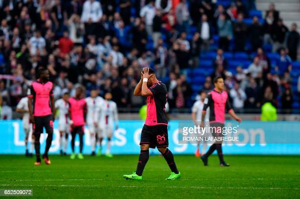 Toulouses French forward Andy Delort reacts during the French L1 football match between Olympique Lyonnais and Toulouse FC on March 12 at the Parc...