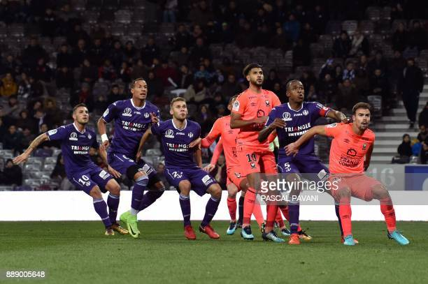 Toulouse's French forward Andy Delort Toulouse's French defender Christopher Jullien Toulouse's French midfielder Alexis Blin Caen's Moroccan...