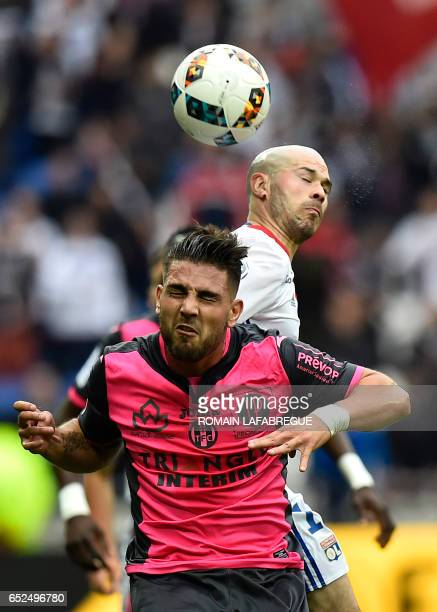Toulouse's French forward Andy Delort vies with Lyon's French defender Christophe Jallet during the French L1 football match between Olympique...