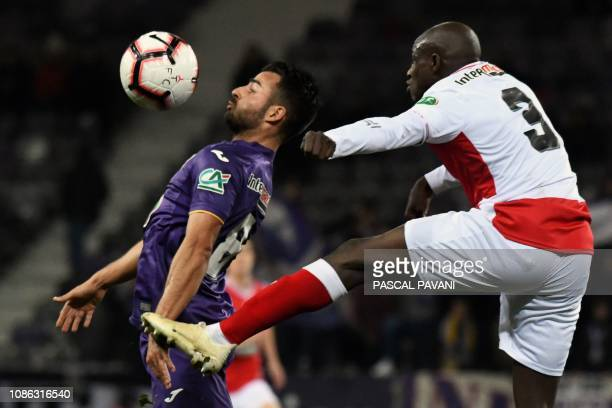 Toulouse's French forward Corentin Jean controls the ball in front of Reims' French defender Hassane Kamara during the French cup football match...