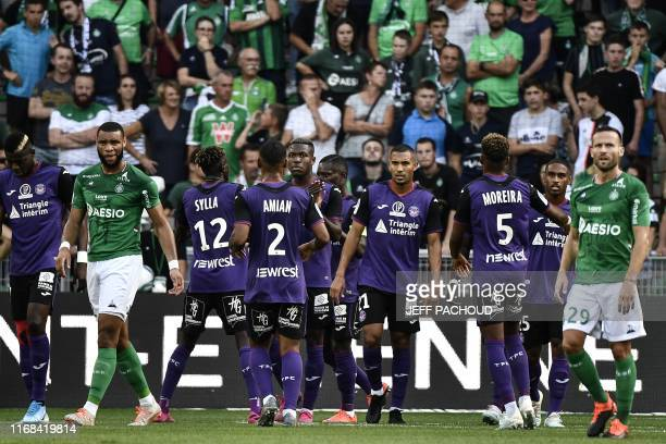 Toulouse's French forward Max Alain Gradel celebrates with his teammates after scoring a goal from the penalty spot during the French L1 football...