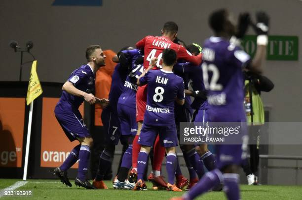Toulouse's French forward Yaya Sanogo celebrates with his teammates after scoring a goal during the French L1 football match Toulouse against...