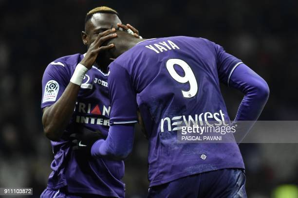 Toulouse's French forward Yaya Sanogo celebrates with teammates after scoring a goal during the French L1 football match Toulouse vs Troyes on...