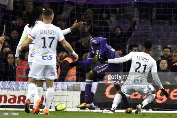 Toulouse's French forward Yaya Sanogo scores a goal during the French L1 football match Toulouse against Strasbourg on March 17 2018 at the Municipal...