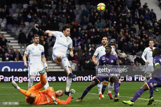 Toulouse's French forward Yaya Sanogo vies for the ball with Strasbourg's Belgian goalkeeper Matz Sels and Strasbourg's French midfielder Jonas...