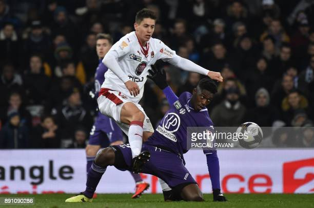 Toulouse's French forward Yaya Sanogo vies for the ball with Bordeaux's French defender Theo Pellenard during the French League Cup round of 16...