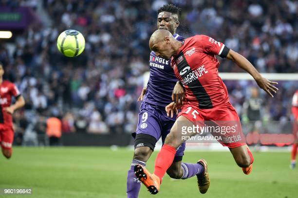 Toulouse's French forward Yaya Sanogo vies for the ball with Guingamp's defender Jeremy Sorbon during the French L1 match between Toulouse and...