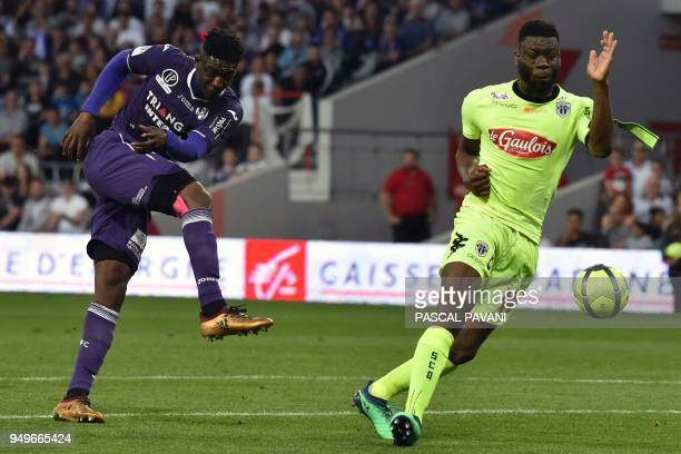 Toulouse's French forward Yaya Sanogo vies with Angers' Ivorian defender Ismael Traore during the French L1 football match Toulouse against Angers...