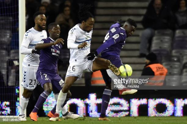 Toulouse's French forward Yaya Sanogo vies with Strasbourg's French defender Bakary Kone during the French L1 football match Toulouse against...