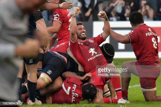 Toulouse's French full back Maxime Medard reacts with teammates after winning at the end of the European Rugby Champions Cup rugby union match...