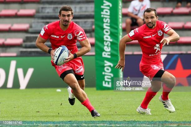 Toulouses French full back Thomas Ramos runs with the ball next to team-player French fly-half Alexi Bales during the European Champions Cup...