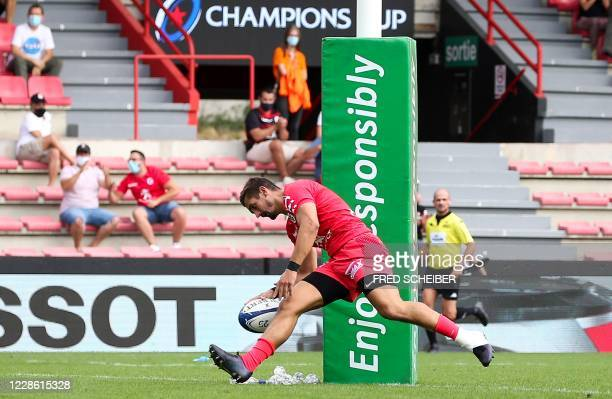 Toulouses French full back Thomas Ramos scores a try during the European Champions Cup quarterfinal rugby union match between Stade Toulousain and...