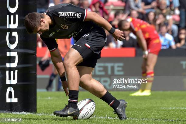 Toulouse's French full back Thomas Ramos scores a try during the French Top14 rugby union match between Toulouse and Perpignan on May 25 2019 at the...