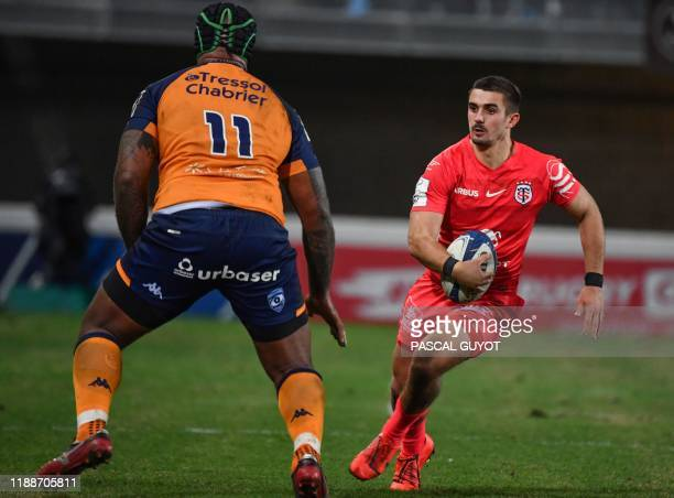 Toulouse's French full back Thomas Ramos vies with Montpellier's Fijian wing Nemani Nadolo during the European Rugby Champions Cup rugby union match...