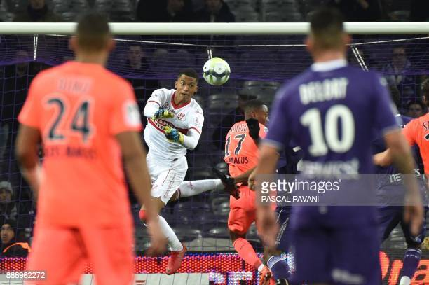 Toulouse's French goalkeeper Alban Lafont deflects a shot during the French L1 football match Toulouse vs Caen on December 9 2017 at the Municipal...