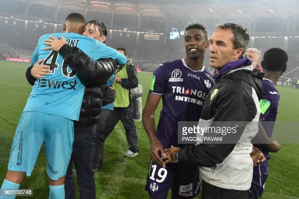 Toulouse's French goalkeeper Alban Lafont Toulouse's French head coach Michael Debeve Toulouse's French forward Yaya Sanogo and Toulouse's French...