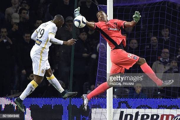 Toulouse's French goalkeeper Alban Lafont vies with Lille's French defender Djibril Sidibe during the French L1 football match between Toulouse and...