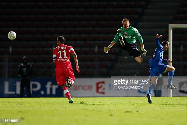 Toulouse's French Goalkeeper Marc Vidal stops the ball during the French League Cup football match Toulouse FC vs US Creteil at Duvauchelle stadium...
