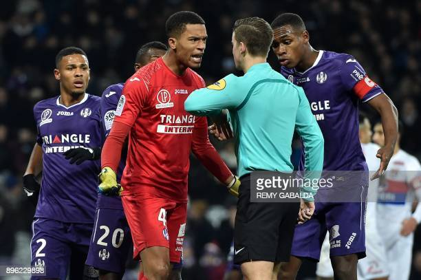 Toulouse's French goalkepper Alban Lafont argues with referee Francois Letexier during the French L1 football match between Toulouse and Lyon on...