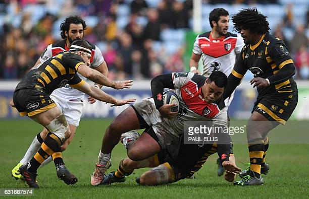 Toulouse's French hooker Christopher Tolofua vies with Wasps' New Zealand centre Jimmy Gopperth and Wasps' South African hooker Ashley Johnson during...