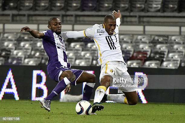 Toulouse's French Ivorian defender Jean AkpaAkpro vies for the ball with Lille's French defender Djibril Sidibe during the French L1 football match...
