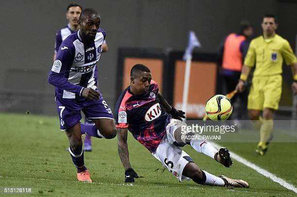 Toulouse's French Ivorian defender Jean AkpaAkpro vies with Bordeaux's Brazilian forward Malcom during the French L1 football match between Toulouse...