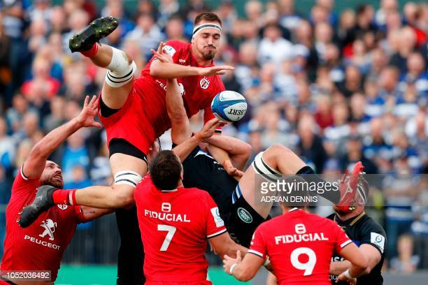 Toulouse's French lock Florian Verhaeghe and Bath's English flanker Tom Ellis compete for the ball in the lineout during the European Rugby Champions...