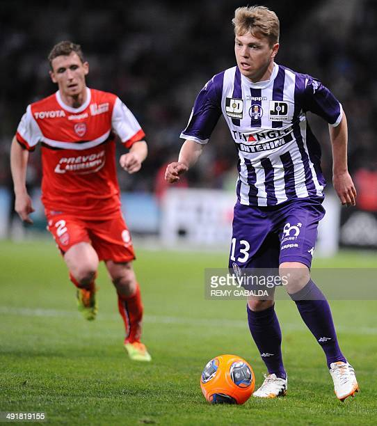 Toulouse's French midfielder Dominik Furman runs with the ball during the French L1 football match between Toulouse and Valenciennes in Toulouse on...