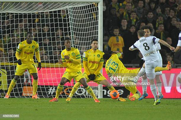 Toulouse's French midfielder Etienne Didot scores a goal during the French L1 football match between Nantes and Toulouse on December 14 2013 at the...