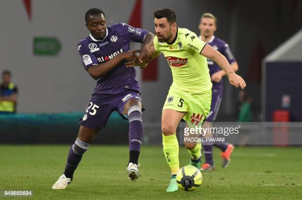Toulouse's French midfielder Gilbert Imbula vies with Angers' French midfielder Thomas Mangani during the French L1 football match Toulouse against...