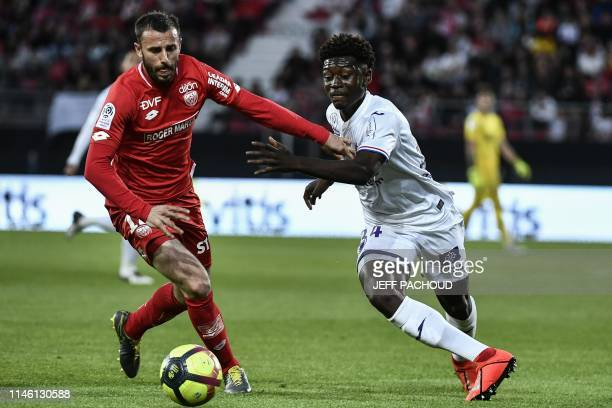 Toulouse's French midfielder Kouadio Kone vies with Dijon's French midfielder Jordan Marie during the French L1 football match between Dijon and...