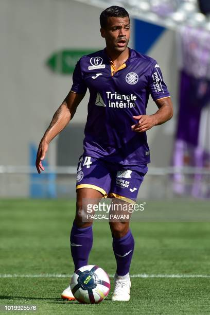Toulouse's French midfielder Matthieu Dossevi runs with the ball during the French L1 football match between Toulouse and Bordeaux on August 19 2018...