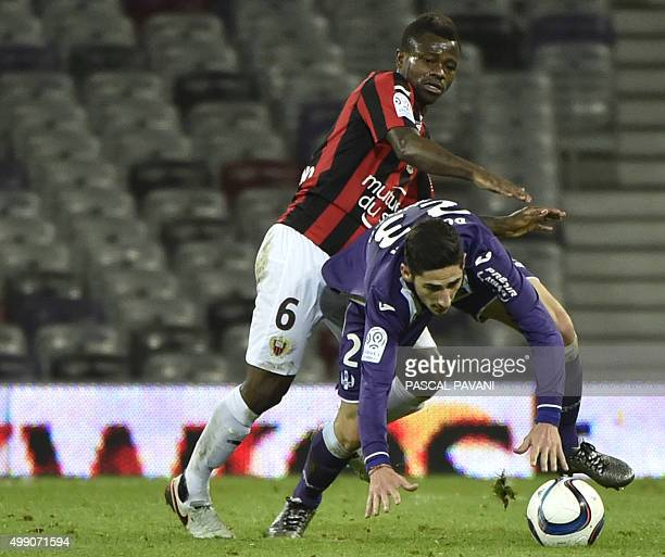 Toulouse's French midfielder Yann Bodiger vies with Nice's Ivorian midfielder Jean Michel Seri during the French L1 football match Toulouse vs Nice...