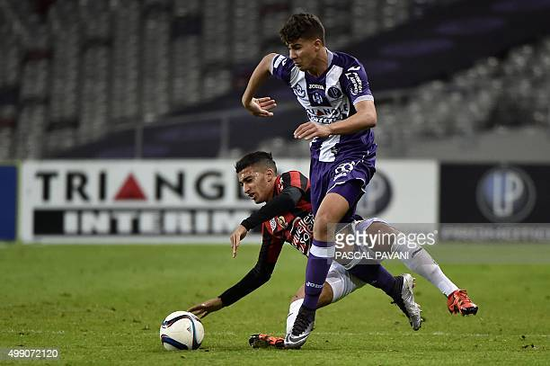 Toulouse's French midfielder Zinedine Machach vies with Nice's Algerian forward Said Benrahma during the French L1 football match Toulouse vs Nice on...