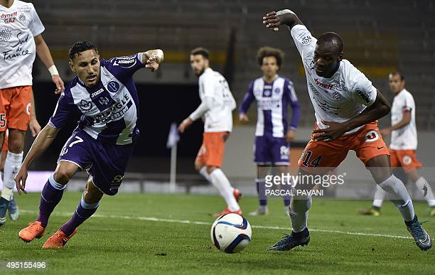 Toulouse's French Moroccan midfielder Adrien Regattin vies with Montpellier's French midfielder Bryan Dabo during the French L1 football match...