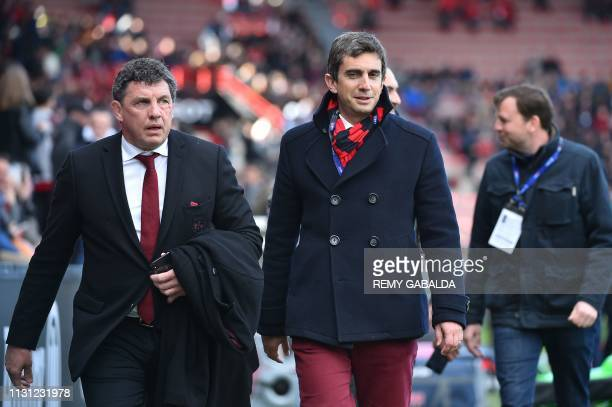 Toulouse's French president Didier Lacroix and Lyon's French president Yann Roubert walk prior to the French Top 14 rugby union match between Stade...