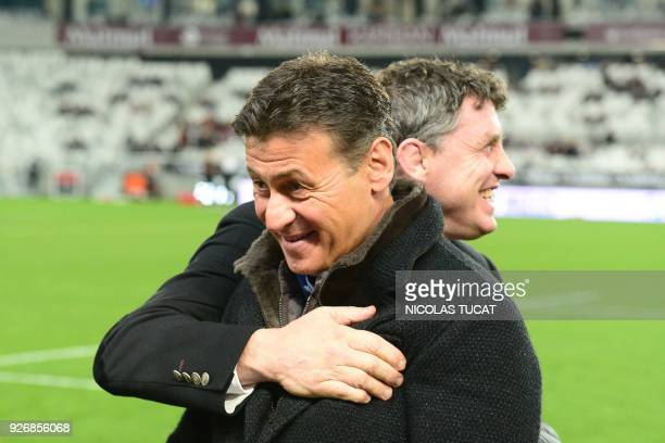 Toulouse's French president Didier Lacroix speaks to BordeauxBegles' French president Laurent Marti prior to the French Top 14 rugby union match...