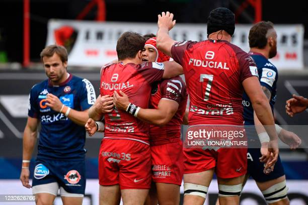 Toulouses French scrum half Antoine Dupont celebrates with teammates during the European Champions Cup semi-final rugby union match between Stade...
